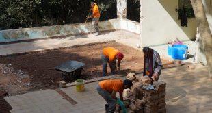 participantes do projeto renascer trabalham em uma obra